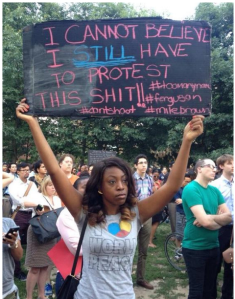 """Image Source: Alternet. August 17, 2014. """"Woman Behind Powerful Mike Brown Protest Photo Defies 'Respectability Politics.'"""""""